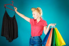 Pinup girl with shopping bags buying skirt. Sale Royalty Free Stock Photography