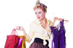 Pinup girl with shopping bags and dress Stock Photography