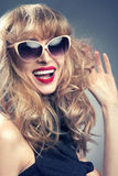 Pinup girl in sunglasses. Royalty Free Stock Photo