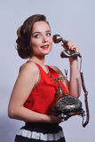 Pinup girl talking on retro telephone Royalty Free Stock Photos