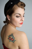 Pinup Girl with Tattoo Stock Images