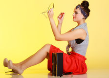 Pinup girl woman applying makeup on yellow. Royalty Free Stock Photos