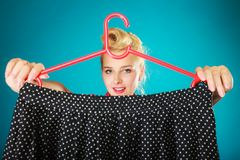 Pinup girl woman buying black skirt. Sale Royalty Free Stock Photography