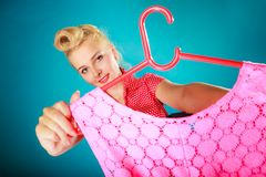 Pinup girl woman buying pink dress. Sale Royalty Free Stock Photography