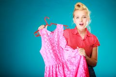 Pinup girl woman buying pink dress. Sale Royalty Free Stock Photos