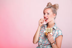 Pinup girl Woman eating chocolate portrait Royalty Free Stock Photos