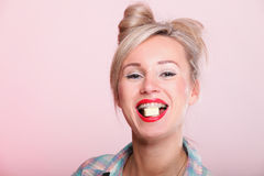 Pinup girl Woman eating chocolate portrait Stock Photos