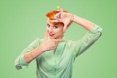 Pinup girl woman making framing key gesture stock images