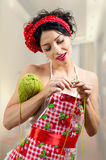 Pinup lady holding needles and ball of thread Royalty Free Stock Photography
