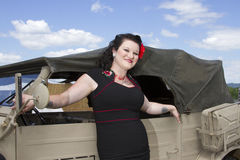 PinUp leaning on Jeep Royalty Free Stock Photo