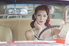 WWII Pinup Model And Muscle Car stock photography
