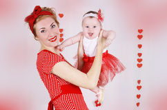 Pinup mother and baby girl with hearts Royalty Free Stock Photography