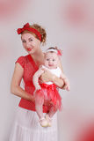 Pinup mother and baby girl standing Stock Photos