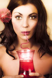 Pinup poster girl drinking at retro cocktail party Royalty Free Stock Photos