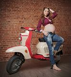 Pinup pregnant woman with retro scooter HDR ver royalty free stock photography
