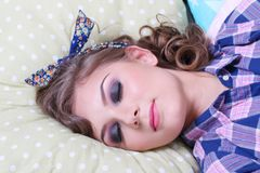 Pinup pretty girl in checkered shirt sleeps Royalty Free Stock Photo