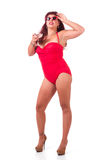 Pinup in red bathing suit Royalty Free Stock Photography