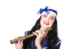 Pinup sailor girl holding telescope Royalty Free Stock Photos