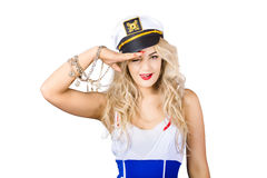 Pinup Sailor woman saluting in captains hat Stock Images