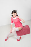 PinUp sexy girl with pink suitcase. Traveling bag Royalty Free Stock Photography