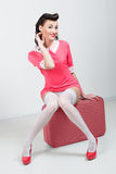 PinUp sexy girl with pink suitcase. Traveling bag Stock Photos