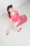PinUp sexy girl with pink suitcase. Traveling bag Stock Photo