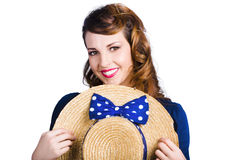 Pinup girl with straw hat Stock Image