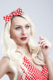 Pinup Style and Concepts. Sexy Sensual Caucasian Blond Woman in Red Dress Royalty Free Stock Photos