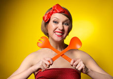 Pinup style housewife with kitchen utensils Royalty Free Stock Image