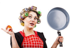 Pinup style housewife with pan Royalty Free Stock Photos