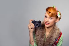 Pinup style woman girl with digital camera royalty free stock images
