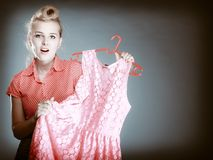Pinup surprised girl buying clothes dress. Sale Stock Images