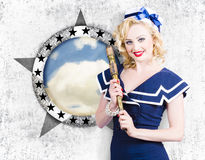 Pinup travel cruise. Seafaring girl with telescope. Attractive pinup girl in nautical uniform holding telescope beside sea port window when on a pin-up travel Stock Image