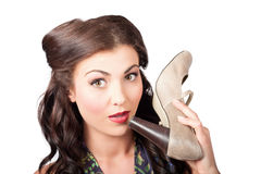 Pinup vintage woman chatting on shoe phone Stock Image