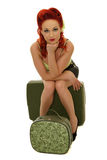 Pinup waiting. Picture of pinup seating on suitcases on white background royalty free stock photo