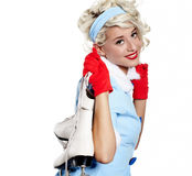 Pinup woman carrying a pair of ice skates. Smiling pinup woman carrying a pair of ice skates Stock Images
