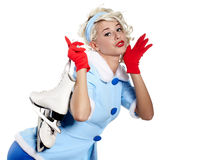 Pinup woman carrying a pair of ice skates. Smiling pinup woman carrying a pair of ice skates Royalty Free Stock Photos