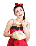 Pinup woman chatting on yellow telephone Royalty Free Stock Image