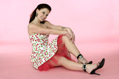 Pinup Woman in a Cherry Dress Stock Images