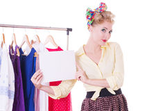 Pinup woman holding blank note over hanger Stock Photos
