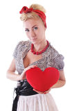 Pinup woman holding plush heart Royalty Free Stock Image