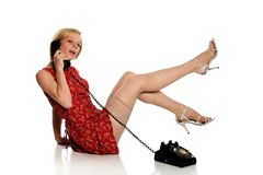 Pinup Woman holding a vintage telephone Stock Photography