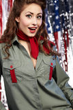 Pinup woman in military clothing Stock Images