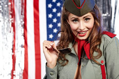 Pinup woman in military clothing Royalty Free Stock Image
