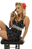Pinup woman on phone. Picture of beautiful blond pinup talking at phone stock photos