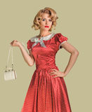 Pinup woman and purse Stock Photos