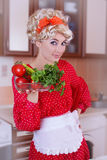 Pinup woman in red with fresh vegetables Stock Photography