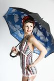 Pinup woman - retro style. Pinup model with umbrella isolated on white background Royalty Free Stock Image