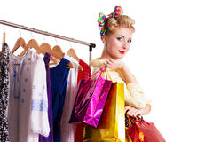Pinup woman with shopping bags and hanger Stock Photography