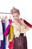Pinup woman with shopping bags and hanger. Isolated on white Stock Photos